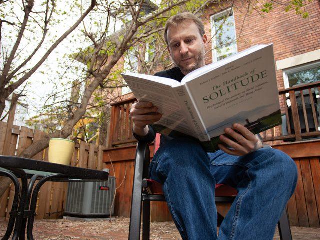 Psychology Professor Robert Coplan reads a book